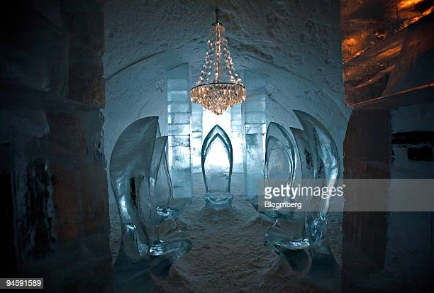 A chandelier hangs above ice chairs in the main hall of the Ice Hotel during the Saab Ice Experience in Jukkasjarvi Sweden Saturday March 17 2007...