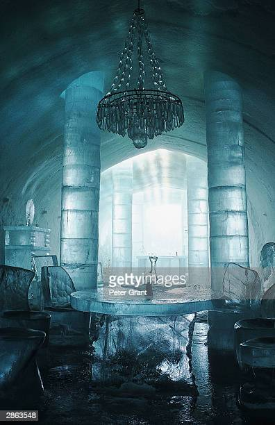 A chandelier hangs above table and chairs in the interior of the Ice Hotel January 2002 in Jukkasjarvi Sweden The 30 000 square foot hotel is...