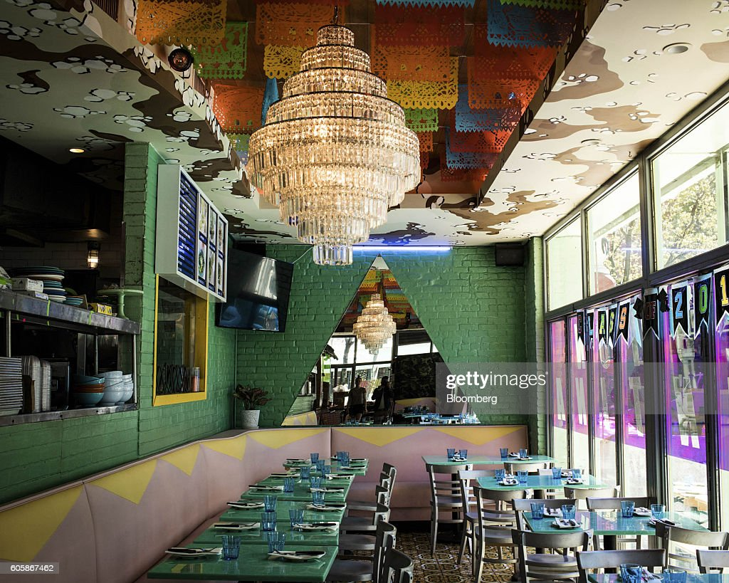 A chandelier hangs inside Mission Cantina restaurant in New York, U.S., on Tuesday, April 19, 2016. Top chefs pick their all-time favorites, from burgers with fat, mid-rare patties dripping with juice to thin, crisp disks of beef smothered with cheese. These are the ones the true masters crave when they're off duty. Photographer: Eric Medsker/Bloomberg via Getty Images