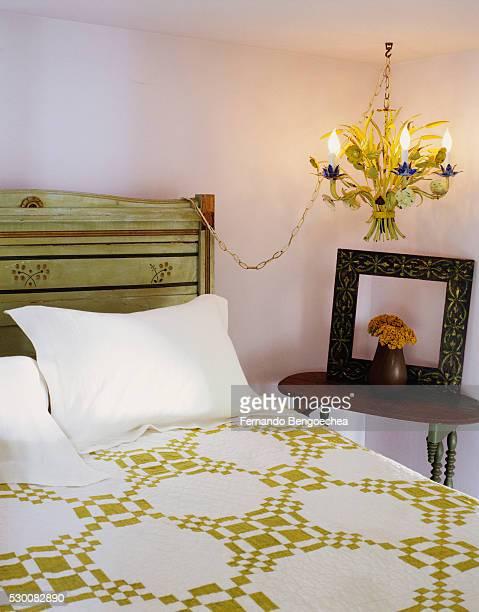 chandelier in corner of bedroom - fernando bengoechea stock pictures, royalty-free photos & images