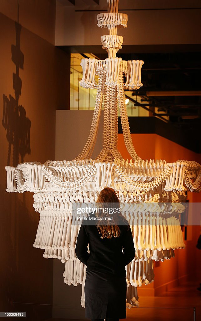 A chandelier made from plaster casts of bones by artist Jodie Carey is displayed at the 'Death: A Self-portrait' exhibition at the Wellcome Collection on November 14, 2012 in London, England. The exhibition showcases 300 works from a unique collection by Richard Harris, a former antique print dealer from Chicago, devoted to the iconography of death. The display highlights art works, historical artifacts, anatomical illustrations and ephemera from around the world and opens on November 15, 2012 until February 24, 2013.