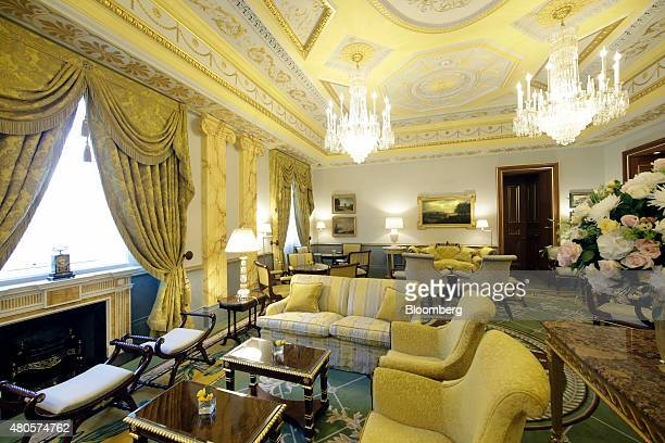 Chandeliers illuminate furniture inside the Withdrawing Room at the Lanesborough luxury 5star hotel operated by the Oetker Group following renovation...