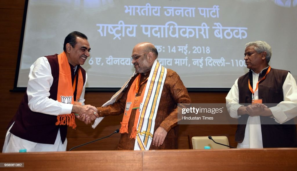 Chandigarh BJP President Sanjay Tandon greets BJP National President Amit Shah as BJP National General Secretary Shri Ramlal looks on during the BJP..