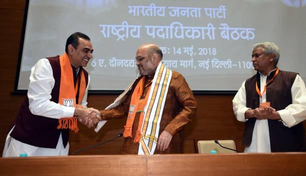 Chandigarh BJP President Sanjay Tandon greets BJP National President Amit Shah as BJP National General Secretary Shri Ramlal looks on during the BJP..