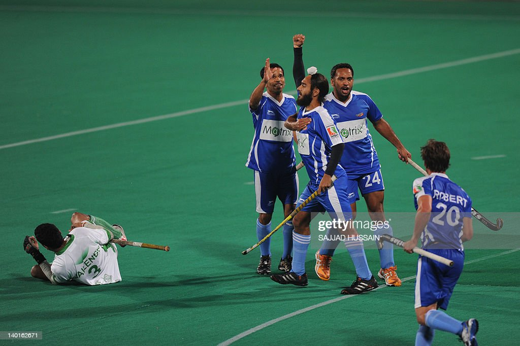 Chandigarh Comets` hockey player Gurjinder Singh celebrates along with his team players after he scores a goal aganist Bhopal Badshahs hockey team...