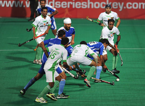 Chandigarh Comets` hockey players in action against Bhopal Badshahs hockey players during the first match of World Series Hockey tournament at a...