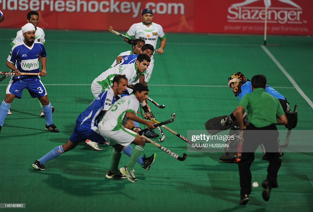 Chandigarh Comets` hockey players in action aganist Bhopal Badshahs` hockey players during the first match of World Series Hockey tournament at a...