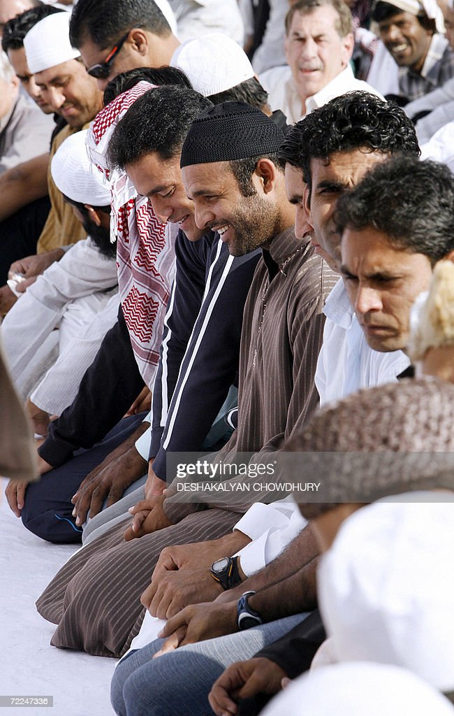 Pakistani cricketer Rana Naved smiles as he offers morning Namaz prayers along with teammates at the Jama Masjid in Chandigarh 24 October 2006...