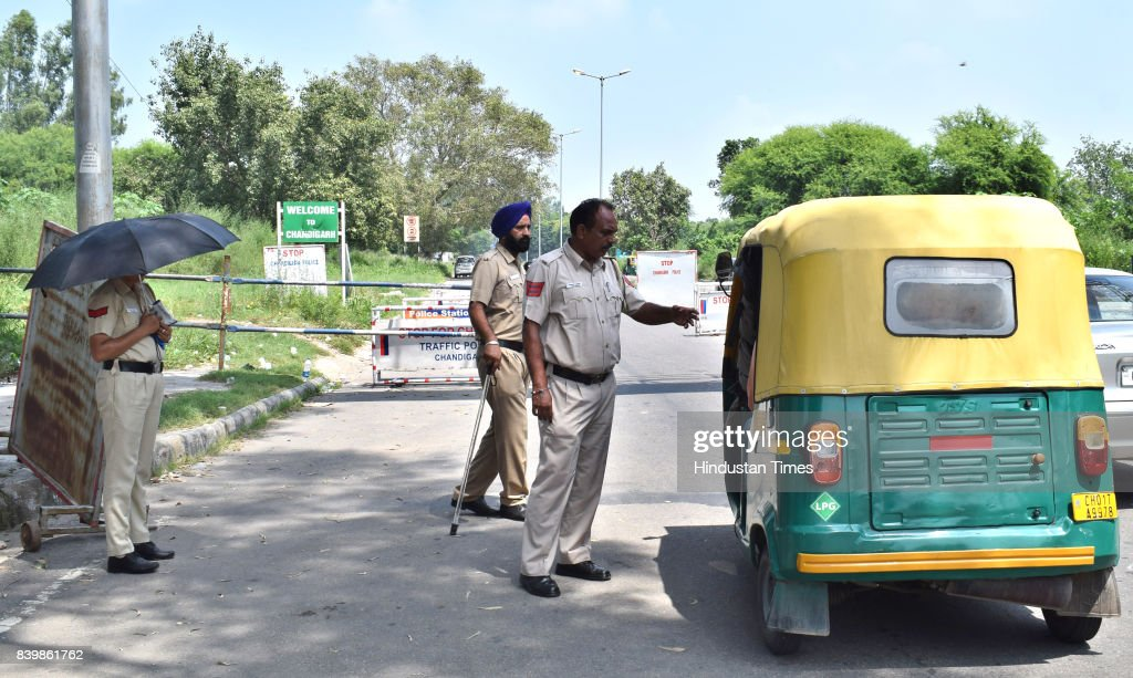 Chandigarh Police checking an autorickshaw at the entry point on August 27 2017 in Chandigarh India Violent clashes across Punjab and Haryana have...