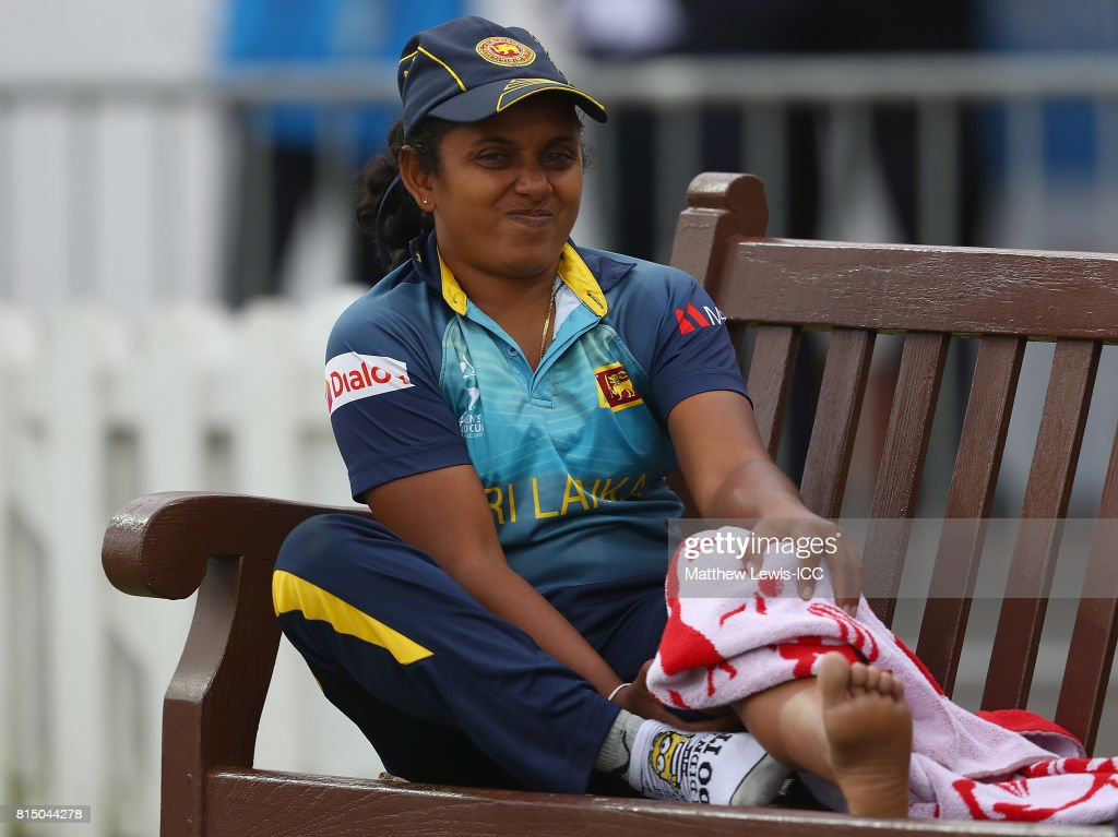 Chandima Gunaratne of Sri Lanka looks on from the dugout, after injuring her knee during the ICC Women's World Cup 2017 match between Pakistan and Sri Lanka at Grace Road on July 15, 2017 in Leicester, England.