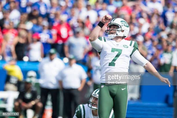 Chandler Catanzaro and Lac Edwards of the New York Jets watches a field goal attempt go through the uprights during the game against the Buffalo...
