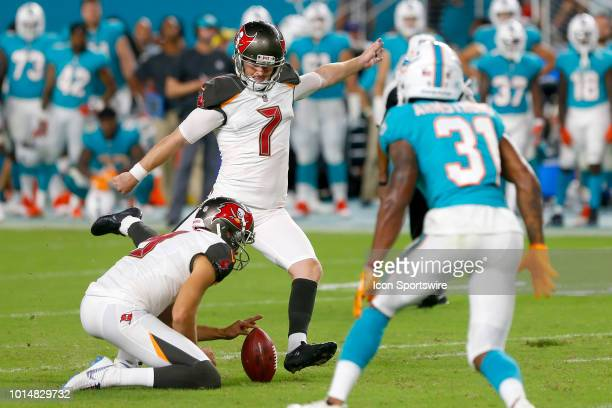 Chandler Catanzaro kicks an extra point from the hold of Bryan Anger during the preseason game between the Tampa Bay Buccaneers and the Miami...