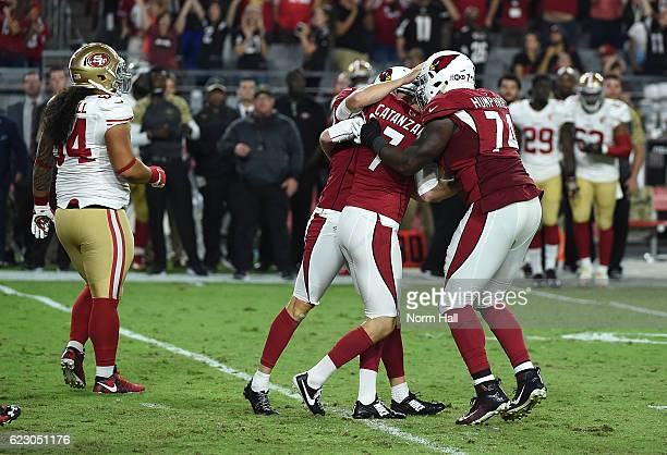 Chandler Catanzaro of the Arizona Cardinals and teammates DJ Humphries and Ryan Quigley celebrate the game winning field goal against the San...