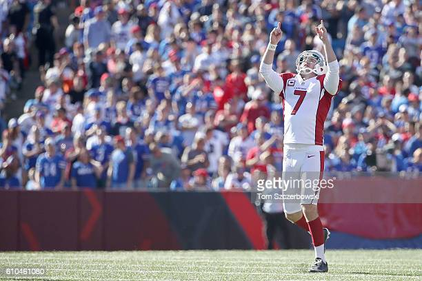 Chandler Catanzaro of the Arizona Cardinals celebrates his 60yard field goal against the Buffalo Bills during the second half at New Era Field on...