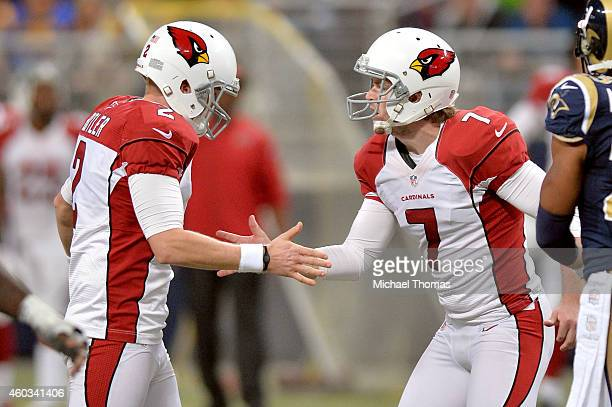 Chandler Catanzaro of the Arizona Cardinals celebrates with Drew Butler after kicking a field goal in the fourth quarter against the St Louis Rams...