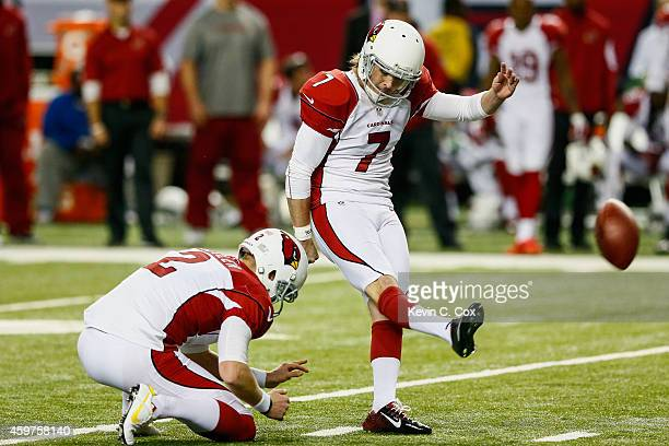 Chandler Catanzaro of the Arizona Cardinals kicks a field goal during the first half against the Atlanta Falcons at the Georgia Dome on November 30...