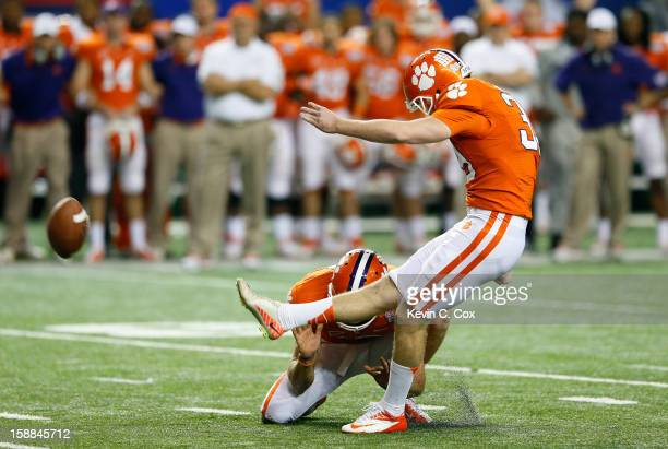 Chandler Catanzaro of the Clemson Tigers kicks the gamewinning field goal against the LSU Tigers during the 2012 ChickfilA Bowl at Georgia Dome on...