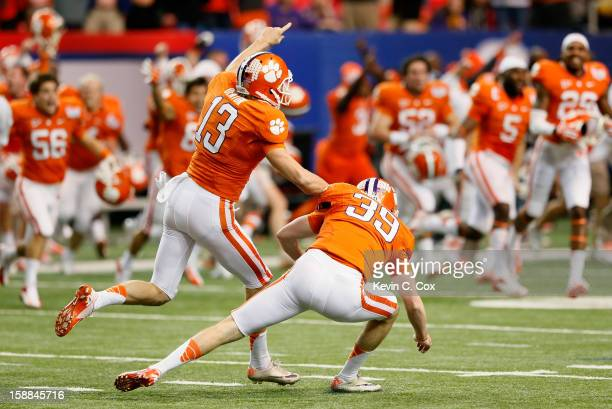 Chandler Catanzaro of the Clemson Tigers reacts with Spencer Benton after kicking the gamewinning field goal against the LSU Tigers during the 2012...