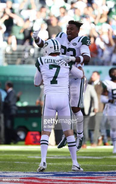 Chandler Catanzaro of the New York Jets celebrates with Jamal Adams after kicking the winning overtime field goal against the Jacksonville Jaguars...