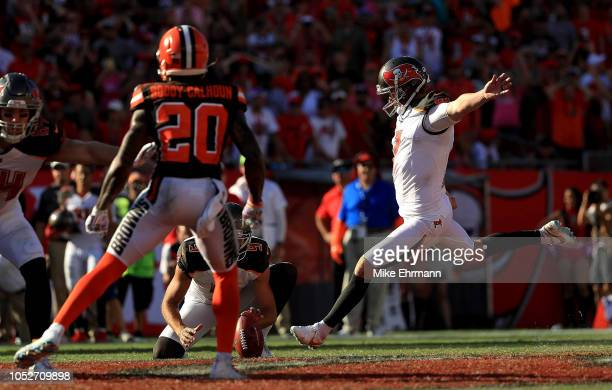 Chandler Catanzaro of the Tampa Bay Buccaneers kicks the game winning field goal in overtime during a game against the Cleveland Browns at Raymond...
