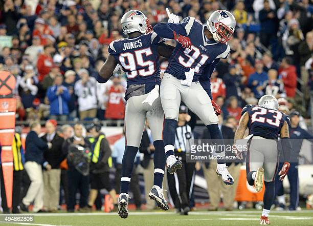 Chandler Jones and Jamie Collins of the New England Patriots react during the second quarter against the Miami Dolphins at Gillette Stadium on...
