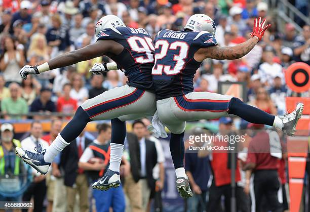 Chandler Jones and Patrick Chung of the New England Patriots celebrate during the fourth quarter against the Oakland Raiders at Gillette Stadium on...