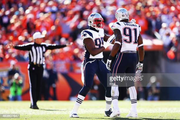 Chandler Jones celebrates with Jamie Collins of the New England Patriots after breaking up a pass in the first quarter against the Denver Broncos...