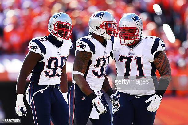 Chandler Jones celebrates with Sealver Siliga and Jamie Collins of the New England Patriots after breaking up a pass in the first quarter against the...
