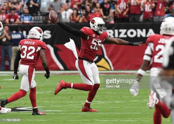 Chandler Jones of the Arizona Cardinals celebrates with Budda Baker after recovering a fumble against the Carolina Panthers during the first half at...