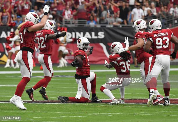 Chandler Jones of the Arizona Cardinals celebrates with DJ Swearinger Sr Budda Baker and teammates after recovering a fumble during the first quarter...