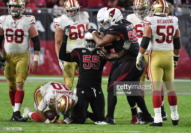 Chandler Jones of the Arizona Cardinals is congratulated by teammate Corey Peters after sacking Jimmy Garoppolo of the San Francisco 49ers during the...