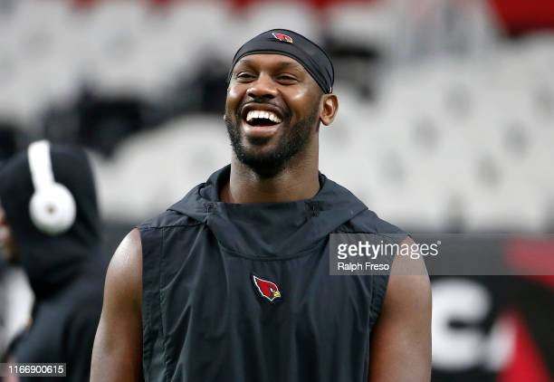 Chandler Jones of the Arizona Cardinals laughs with teammates prior to the start of the NFL preseason game against the Los Angeles Chargers at State...