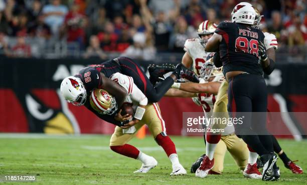 Chandler Jones of the Arizona Cardinals sacks Jimmy Garoppolo of the San Francisco 49ers during the game at State Farm Stadium on October 31 2019 in...