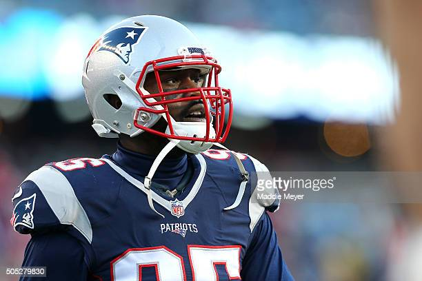 Chandler Jones of the New England Patriots looks on during warm ups prior to the AFC Divisional Playoff Game against the Kansas City Chiefs at...