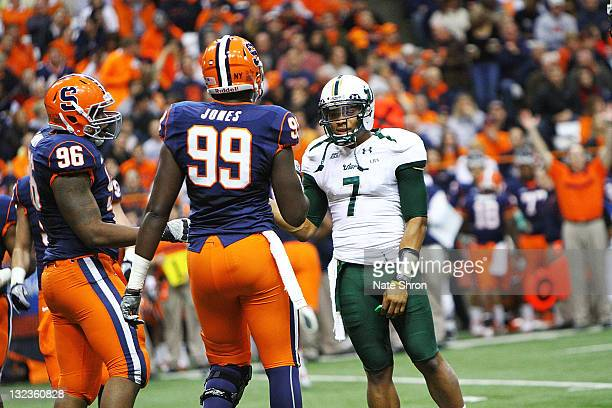 Chandler Jones of the Syracuse Orange receives a penalty and discusses on the field with BJ Daniels of the South Florida Bulls during the game at the...