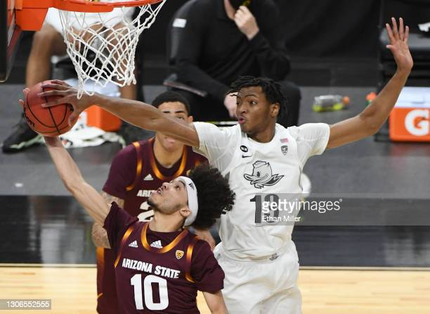 Chandler Lawson of the Oregon Ducks blocks a shot by Jaelen House of the Arizona State Sun Devils during the quarterfinals of the Pac-12 Conference...