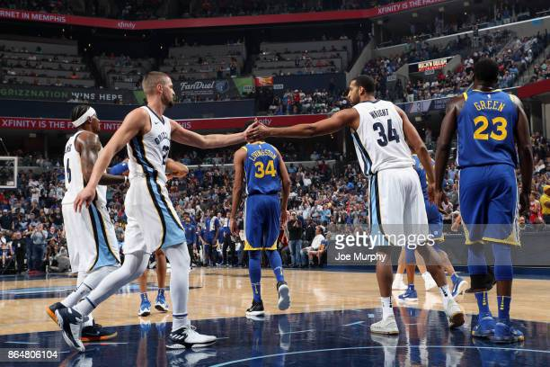 Chandler Parsons and Brandan Wright of the Memphis Grizzlies high five during the game against the Golden State Warriors on October 21 2017 at...