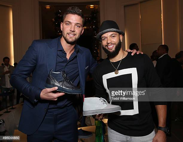 Chandler Parsons and Deron Williams attend a Del Toro Chandler Parsons Event at Saks Fifth Avenue Beverly Hills on October 30 2015 in Beverly Hills...