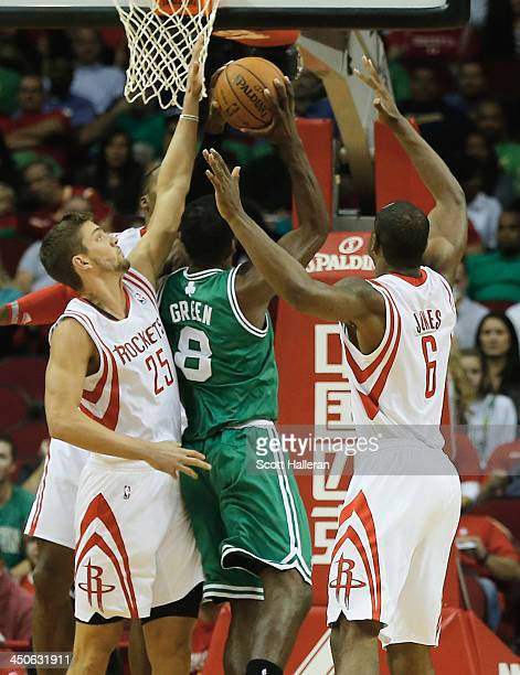 Chandler Parsons and Terrence Jones of the Houston Rockets defend against Jeff Green of the Boston Celtics at the Toyota Center on November 19 2013...