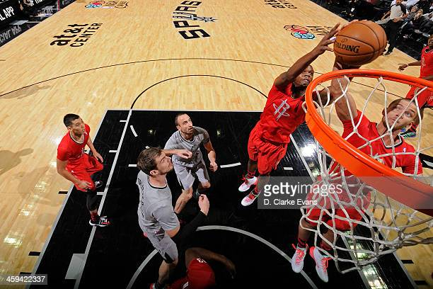 Chandler Parsons and Terrence Jones of the Houston Rockets grabs a rebound against the San Antonio Spurs during the game at the ATT Center on...