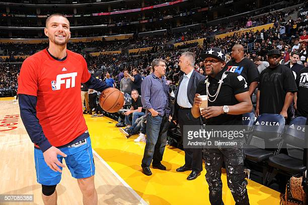 Chandler Parsons of the Dallas Mavericks and Floyd Mayweather talk before the game against the Los Angeles Lakers on January 26 2016 at STAPLES...