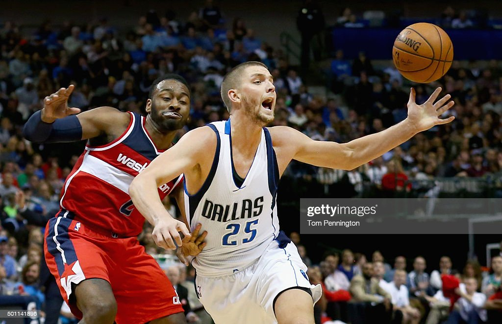 Chandler Parsons #25 of the Dallas Mavericks drives to the basket against John Wall #2 of the Washington Wizards in the first half at American Airlines Center on December 12, 2015 in Dallas, Texas.