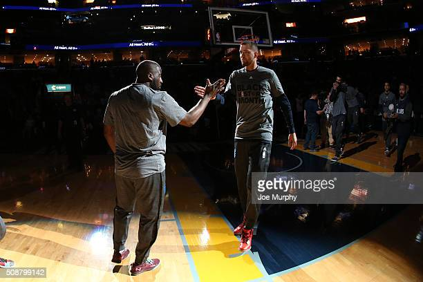 Chandler Parsons of the Dallas Mavericks shakes hands with Raymond Felton of the Dallas Mavericks before the game against the Memphis Grizzlies on...