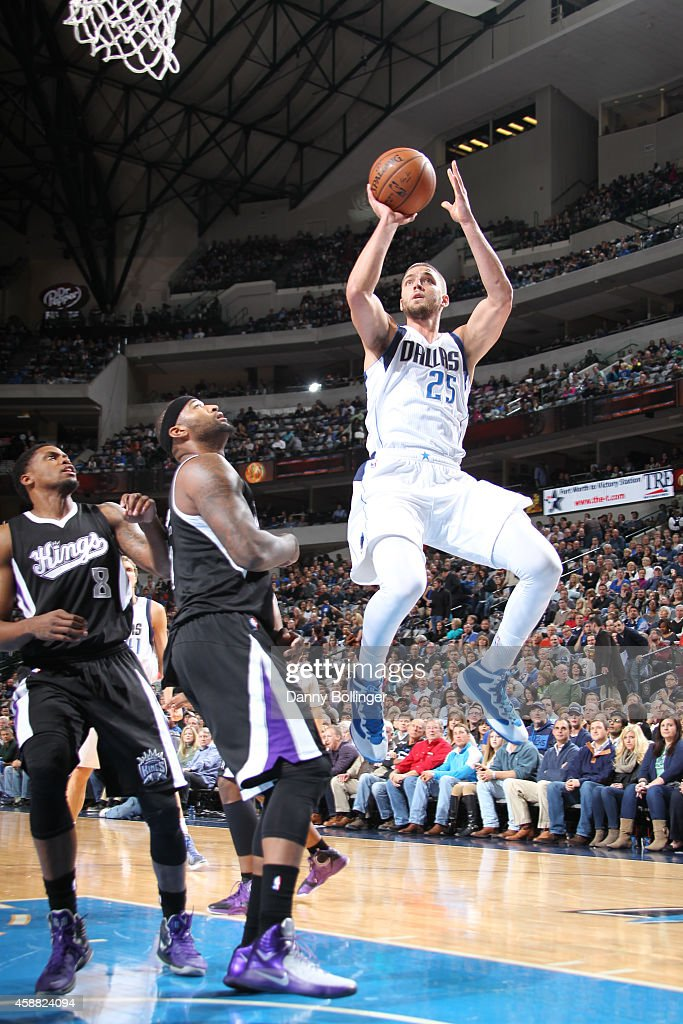 Chandler Parsons #25 of the Dallas Mavericks shoots a running jumper against DeMarcus Cousins #15 of the Sacramento Kings on November 11, 2014 at the American Airlines Center in Dallas, Texas.