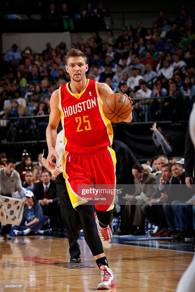 Chandler Parsons #25 of the Houston Rockets brings the ball up court against the Dallas Mavericks on March 6, 2013 at the American Airlines Center in Dallas, Texas.