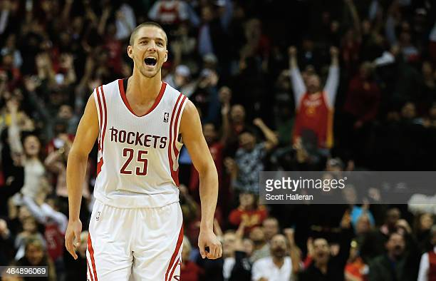 Chandler Parsons of the Houston Rockets celebrates a threepointer against the Memphis Grizzlies during the game at the Toyota Center on January 24...