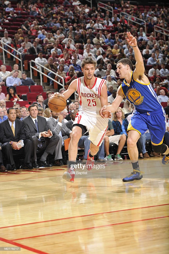 Chandler Parsons #25 of the Houston Rockets drives to the basket against the Golden State Warriors on February 5, 2013 at the Toyota Center in Houston, Texas.