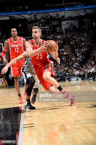 Chandler Parsons of the Houston Rockets drives to the basket against the San Antonio Spurs at the ATT Center on November 30 2013 in San Antonio Texas...