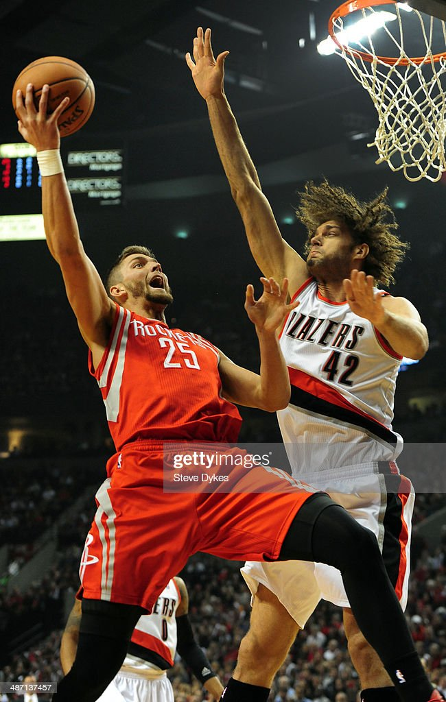 Chandler Parsons #25 of the Houston Rockets drives to the basket against Robin Lopez #42 of the Portland Trail Blazers in the first quarter of Game Four of the Western Conference Quarterfinals during the 2014 NBA Playoffs at the Moda Center on April 27, 2014 in Portland, Oregon.