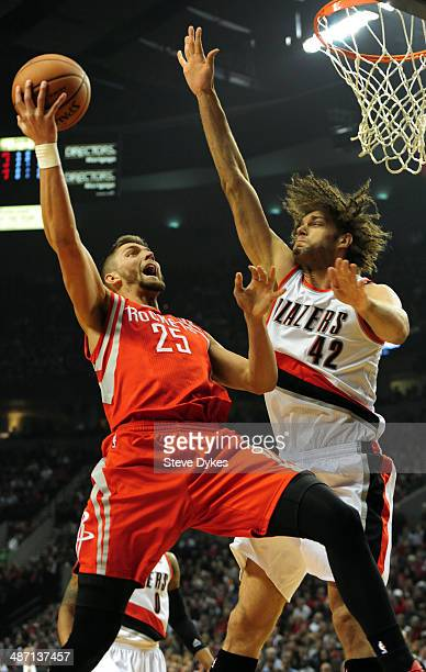 Chandler Parsons of the Houston Rockets drives to the basket against Robin Lopez of the Portland Trail Blazers in the first quarter of Game Four of...